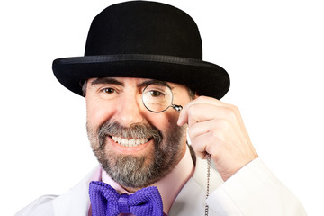 Portrait of happy middle-aged man in a hat with a monocle in his