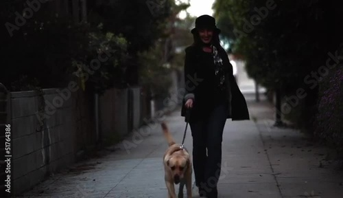 Stylish woman walking excited dog