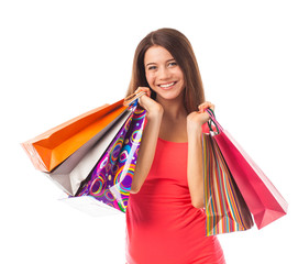 Smiling young woman holding shopping bags