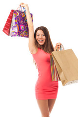 Cheerful brunette with shopping bags