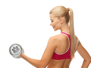 woman with heavy steel dumbbell