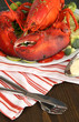 Red lobster on platter on table close-up