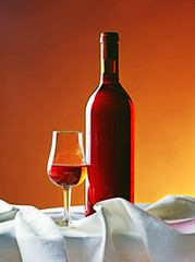 Red wine bottle with gass