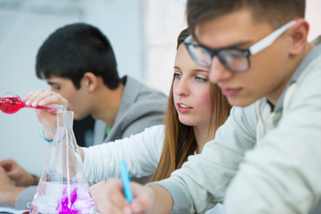 High School students. Group of students working at chemistry cla