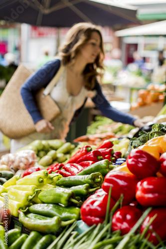 Fotobehang Boodschappen Young woman at the market