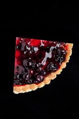 piece of berry pie isolated on black