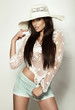 Beautiful summer girl posing in white hat