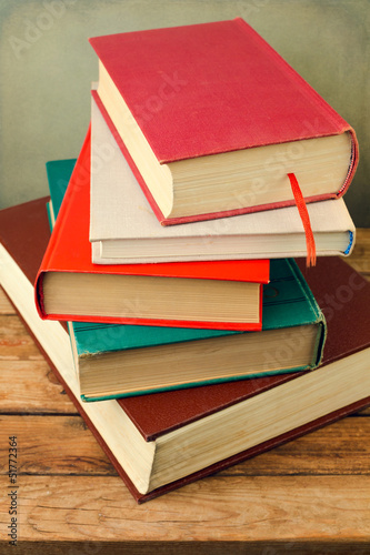 Bunch of books on wooden table