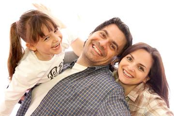 Famiglia, papà e mamma che giocano con la figlia