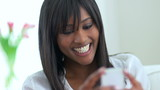 Smiling African American woman on mobile phone