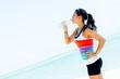 Sports woman drinking water