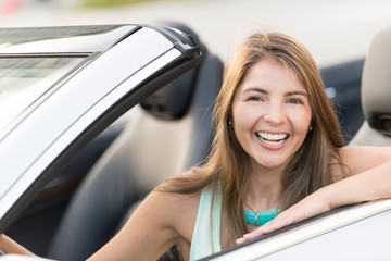 Happy woman driving a car