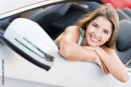 Woman in a convertible car