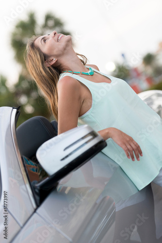Happy woman with her car