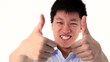 Asian young man showing two thumbs up gesture