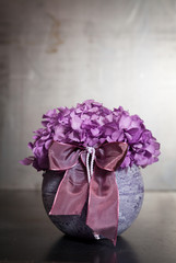 Centerpiece of purple hydrangea bouquet.