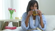 Black woman with flu drinking tea