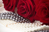 Beautiful jewelry background and red roses