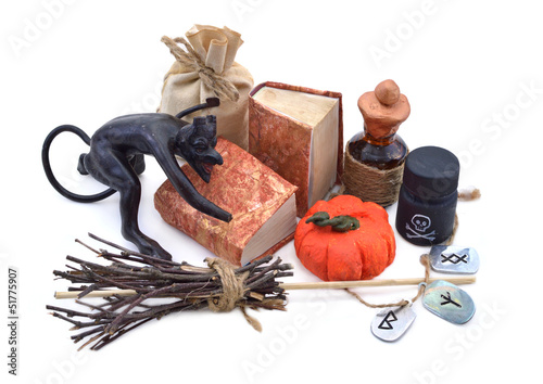 Devil figurine with halloween objects