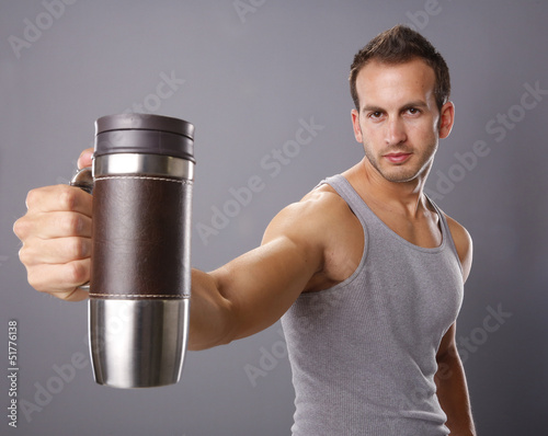 Handsome man and a coffee mug