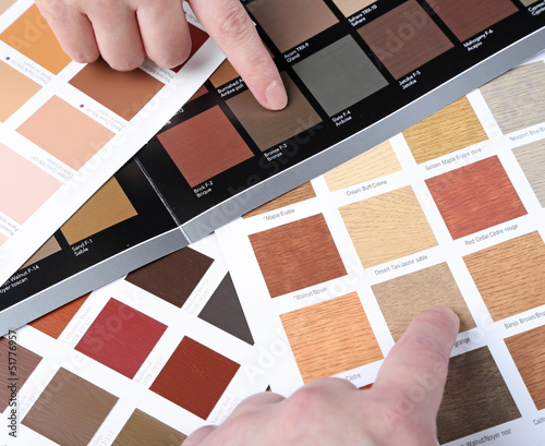 Hands pointing to sample color chart