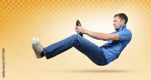 Man car driver with a wheel, yellow taxi concept