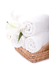 Beautiful lilly on towels rolls
