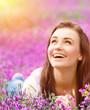 Beautiful woman on floral field