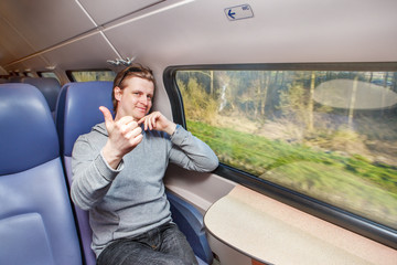 Passenger in train showing thumb up