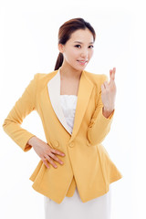 Young Asian business woman showing lucky sign