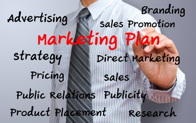 business man writing marketing plan concept