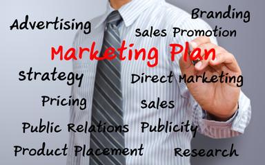 business man writing marketing plan concept