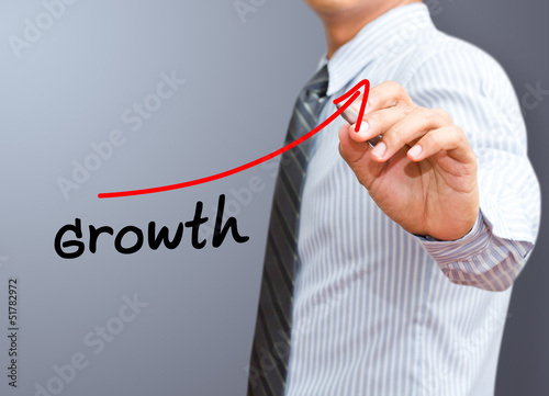 Businessman drawing a  growth diagram