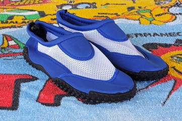 Blue beach shoes © Arena Photo UK