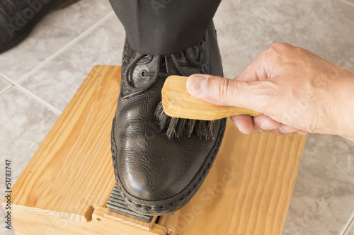 shining shoes to a businessman