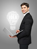 businessman with laptop and lamp