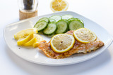 Baked Salmon with Sliced Lemons and Cucumbers