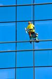 Washer wash the windows of modern skyscraper