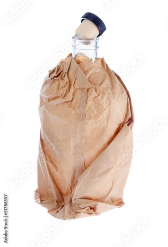 Open alcohol bottle in paper bag.