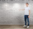 casual young attractive man standing in front of a vintage wall