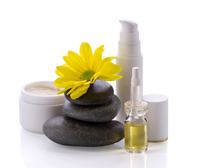 spa accessories, cosmetic products and flower