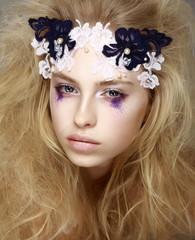 Brightly Painted Woman's Skin - Blue Eyeshadow. Meekness