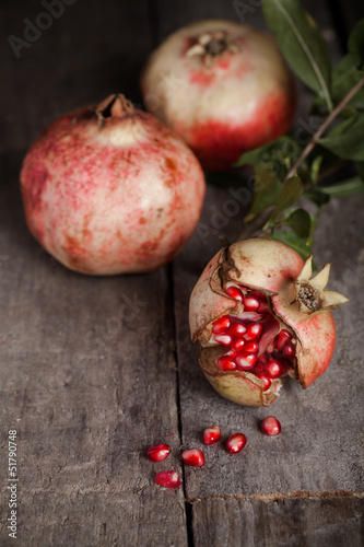 fresh pomegranate on wooden table.
