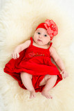 top view of beautiful baby in red dress
