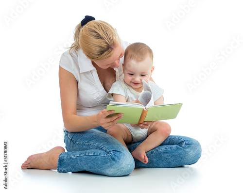 mother reading a book to her baby boy