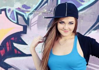 Smiling Teenager Girl Posing near Wall