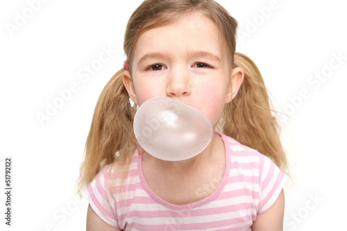 Cute little girl blowing a bubble from chewing gum