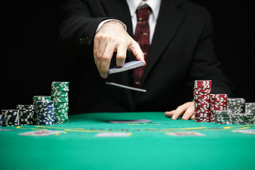 casino worker shuffling cards