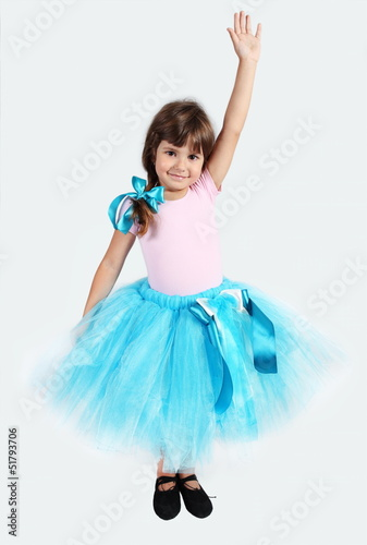Smiling Girl in Tutu Skirt Hand Up