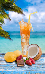 splash of iced tea in tropical sea